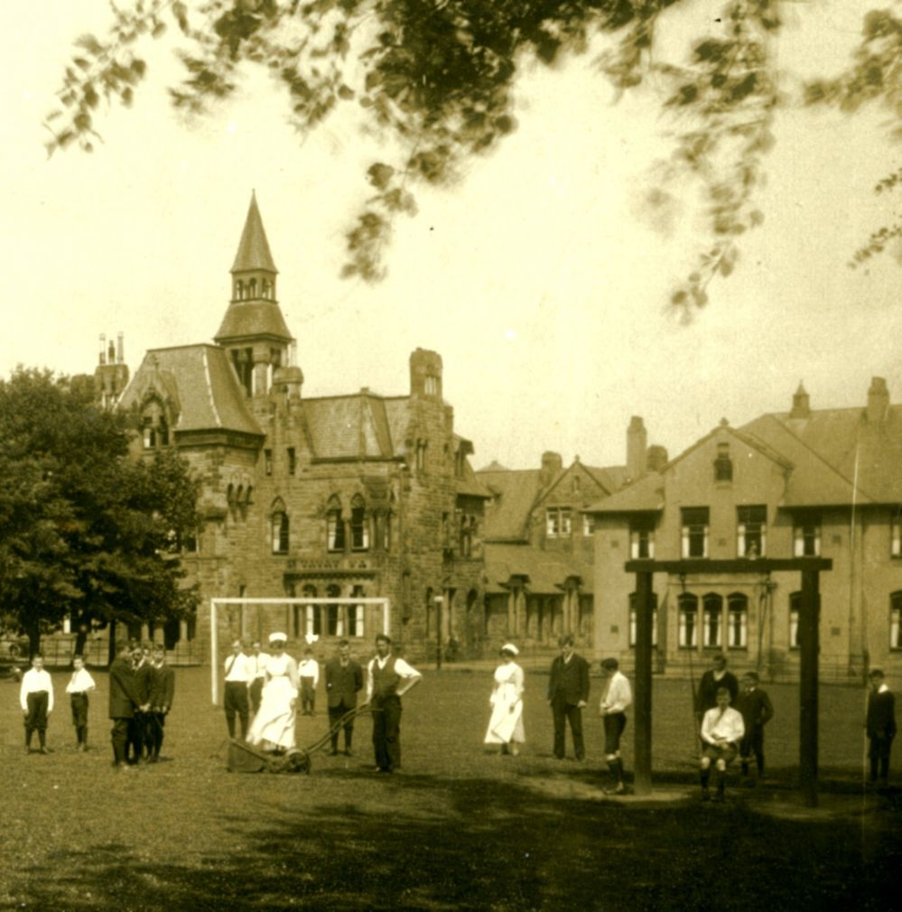 Photograph of staff and patients in the grounds of the hospital, c1910. Image courtesy of University of Stirling.